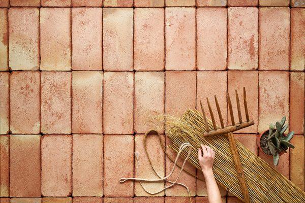 Close up of a terracotta ceramic salmon tiles floor